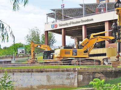 Heavy equipment on banks of Buffaly Bayou at UHD