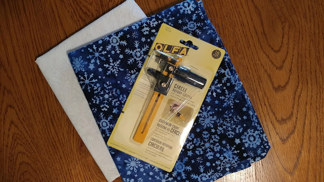 Olfa rotary circle cutter and Island Batik Alpine Ice fabrics