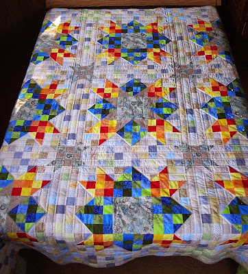 http://sewfreshquilts.blogspot.ca/2013/07/finished-oh-my-scrappy-stars-just-under.html