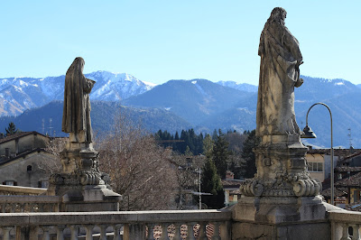 Statues of two of the four evangelists look south from the main church in Clusone