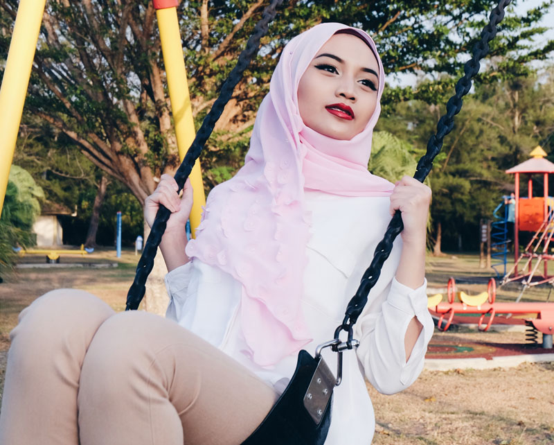 Brunei Hijjabi on a swing set