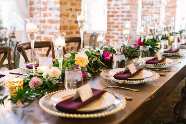 purple table setting and centerpieces