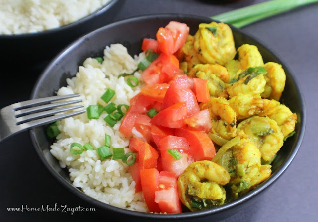 An easy, 30 minute meal for curry shrimp paired with rice infused with coconut.