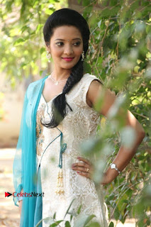 Tamil Actress Koushika Stills in White Salwar Kameez at Inayathalam Tamil Movie Audio Launch  0003.jpg