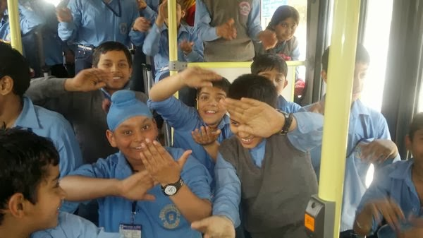 Students dancing in HOHO Bus