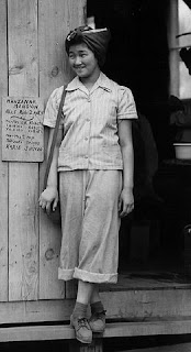 "Clem Albers, ""Manzanar, Calif.—In the doorway of her barrack apartment at this War Relocation Authority center for evacuees of Japanese ancestry,"" 1942 Courtesy National Archives and Records Administration"