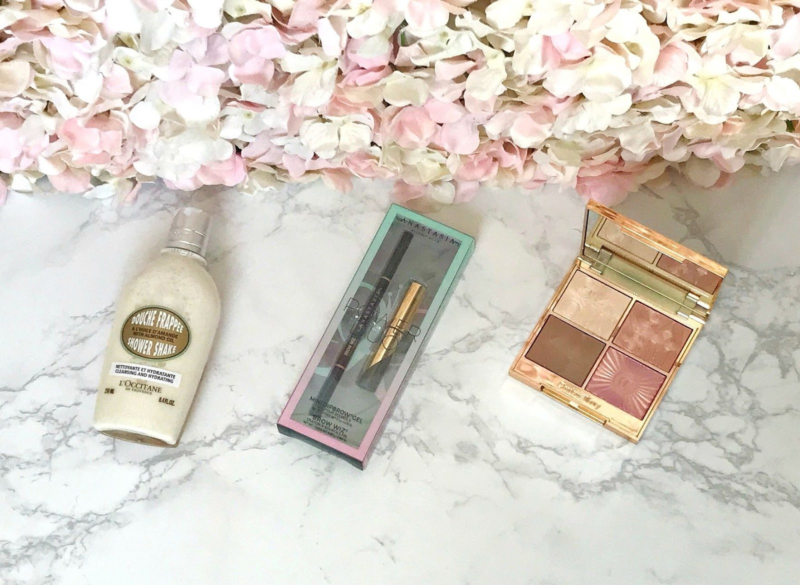 L'Occitane Almond Shower Shake, Anastasia Beverly Hills power Duo, Charlotte Tilbury Lightgasm