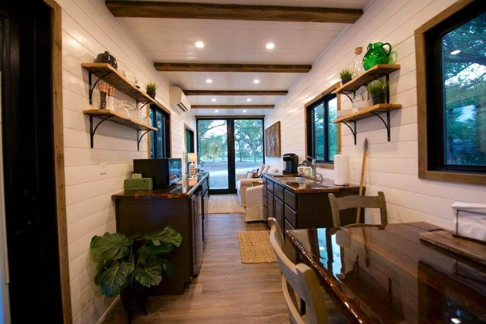 03-Dining-Kitchen-and-Living-Room-Cargohome-Sustainable-Two-Story-Tiny-Home-Shipping-Containers-www-designstack-co