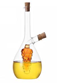 Yağ ve sirkenin aynı cam şişe içinde ancak karışmadan durduğu iki bölümlü cam yağdanlık ve sirkelik