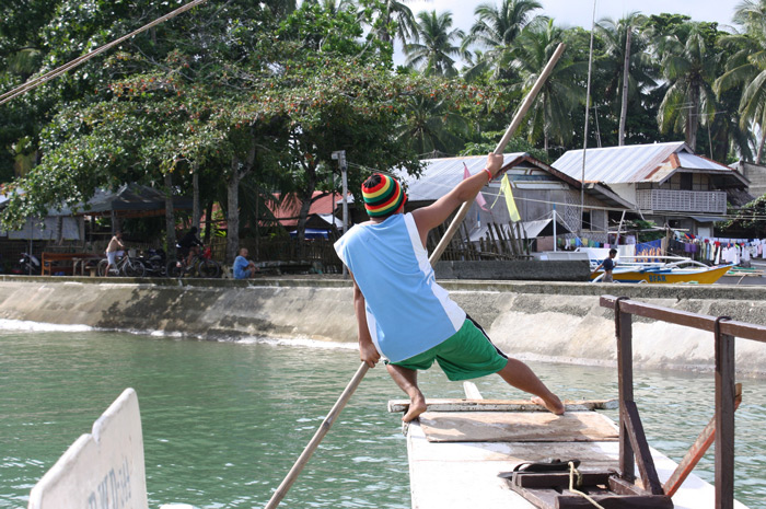 A skillful boat crew assisting us during our boat ride to Canigao Island