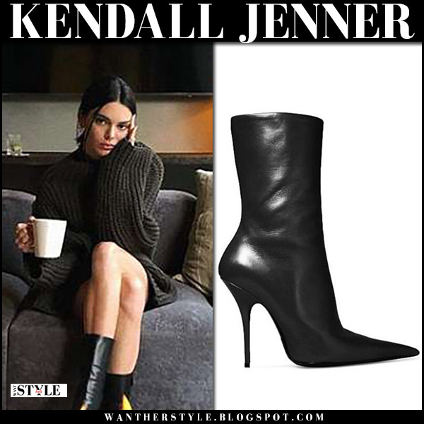 Kendall Jenner in chunky knit oversized sweater and black leather boots balenciaga knife model style april 19