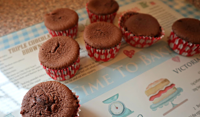 Chocolate cupcakes, sunken in the middle.