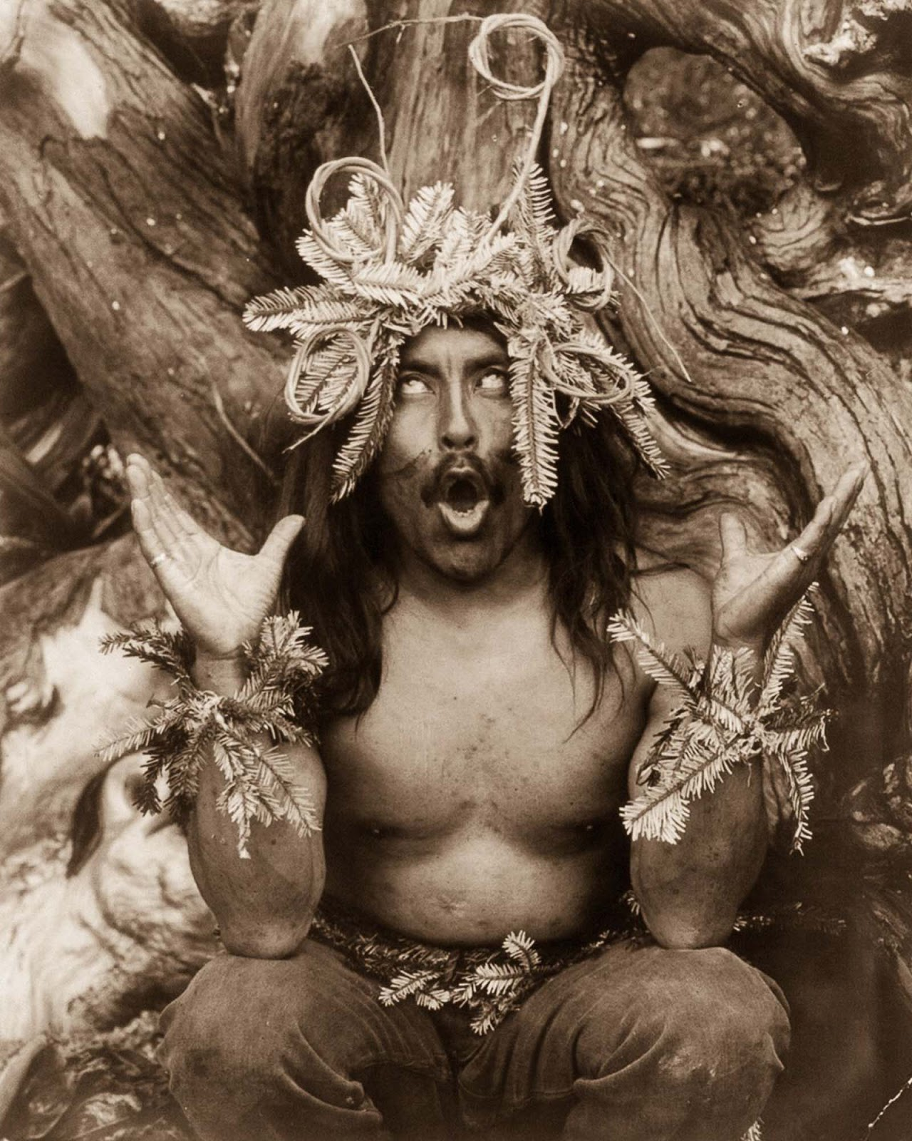 A Kwakiutl shaman performs a religious ritual. 1914.