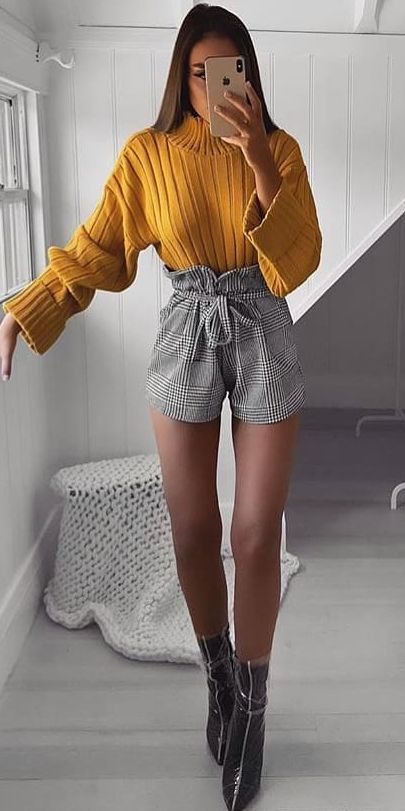 High neck knit jumper in mustard, paper bag waist shorts | From knit sweaters to knit sweater dress, knit cardigan dress to knitting cardigan. There are so much to try in knitwear fashion. Here are 25 cute knit outfits ideas to wear. knitting clothes and knitted outfits via higiggle.com #sweaters #knit #outfits #style