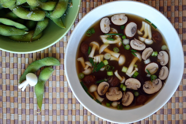 a bowl of miso soup with edamame beans