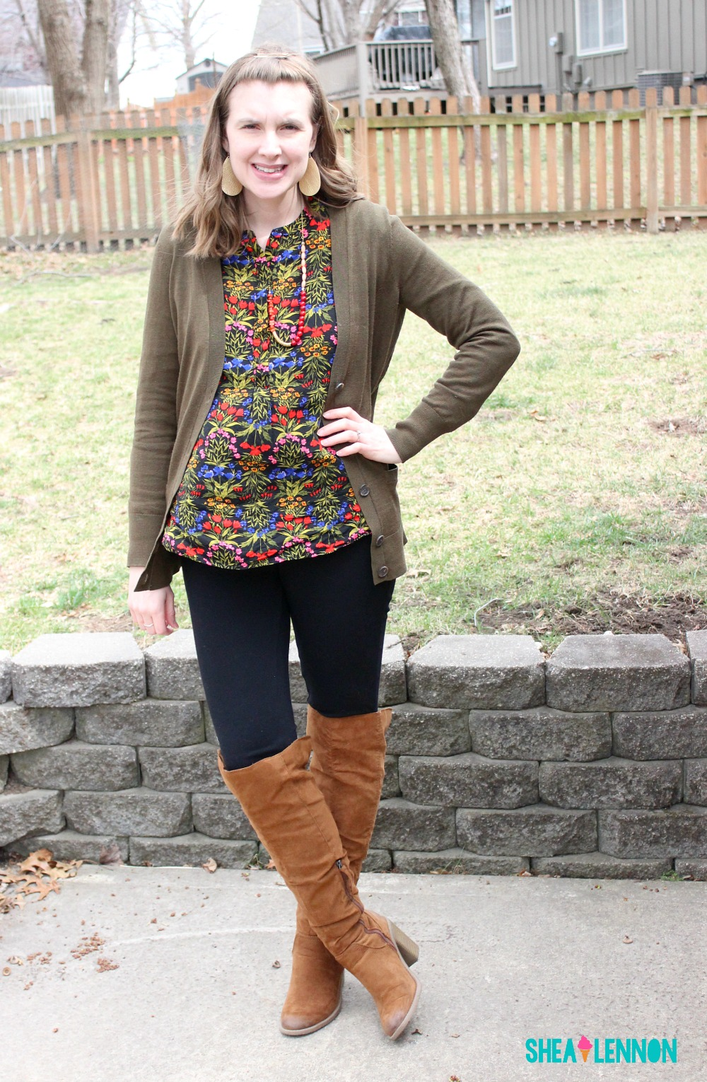 Winter outfit idea featuring a floral top, olive cardigan, ponte pants, and over the knee boots.