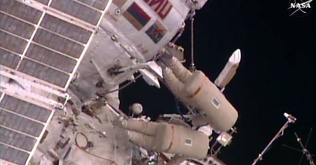 Spacewalkers Yuri Malenchenko and Sergey Volkov work outside the Pirs docking compartment on gear installation and science experiments. Credit: NASA TV