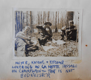 "Three students eating lunch and drinking beer near Lake Champlain. Caption includes ""That is Not Budweiser"""""