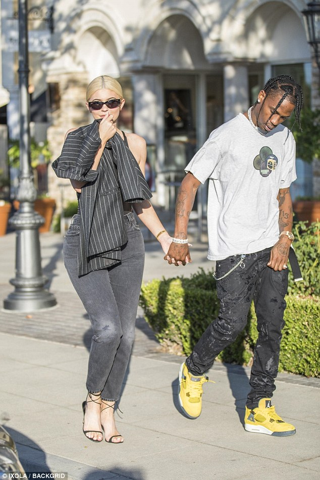 Kylie Jenner flaunts her sensational curves as she shops with baby daddy Travis Scott
