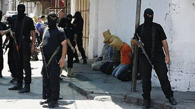 Hamas militants executing alleged collaborators with Israel in August 2014