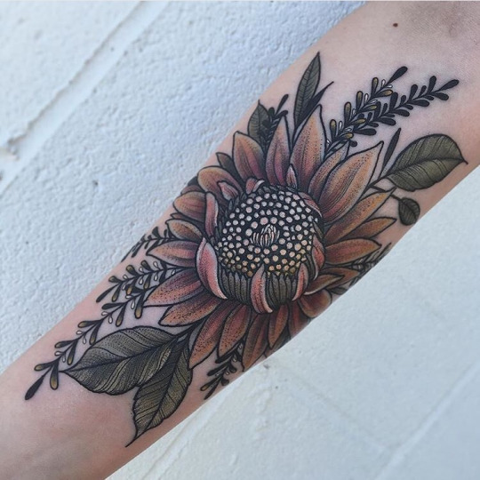 Sunflower with leaf forearm tattoo