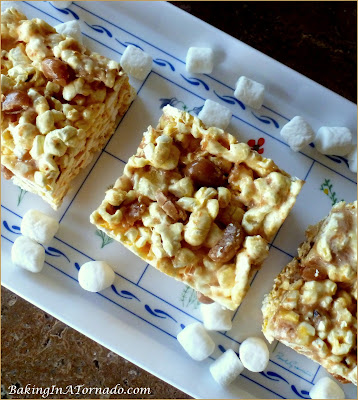 Caramel Studded Popcorn Treats, made with toasted coconut marshmallows, crunchy popcorn and studded with caramel candies, this treat is quick and easy to make and fun to serve. | Recipe developed by www.BakingInATornado.com | #recipe #treat