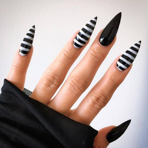 Love these Tim Burton inspired Black & White striped nails