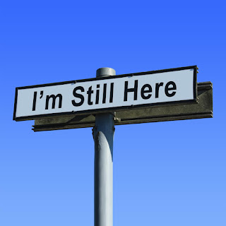 sign that says I'm Still Here