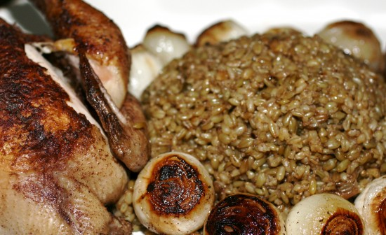 Roasted Freekeh ma' djej and onions in a dish