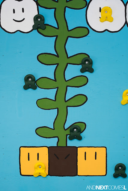 Close up of Super Mario themed DIY climbing wall for kids