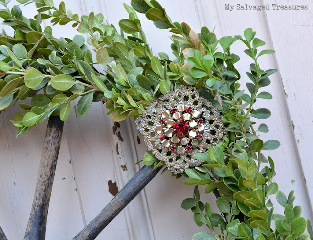 boxwood wreath with vintage jewelry