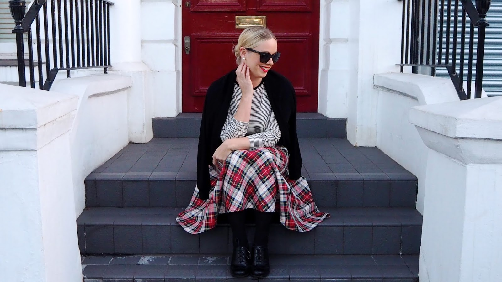black and white striped shirt and red & green plaid skirt