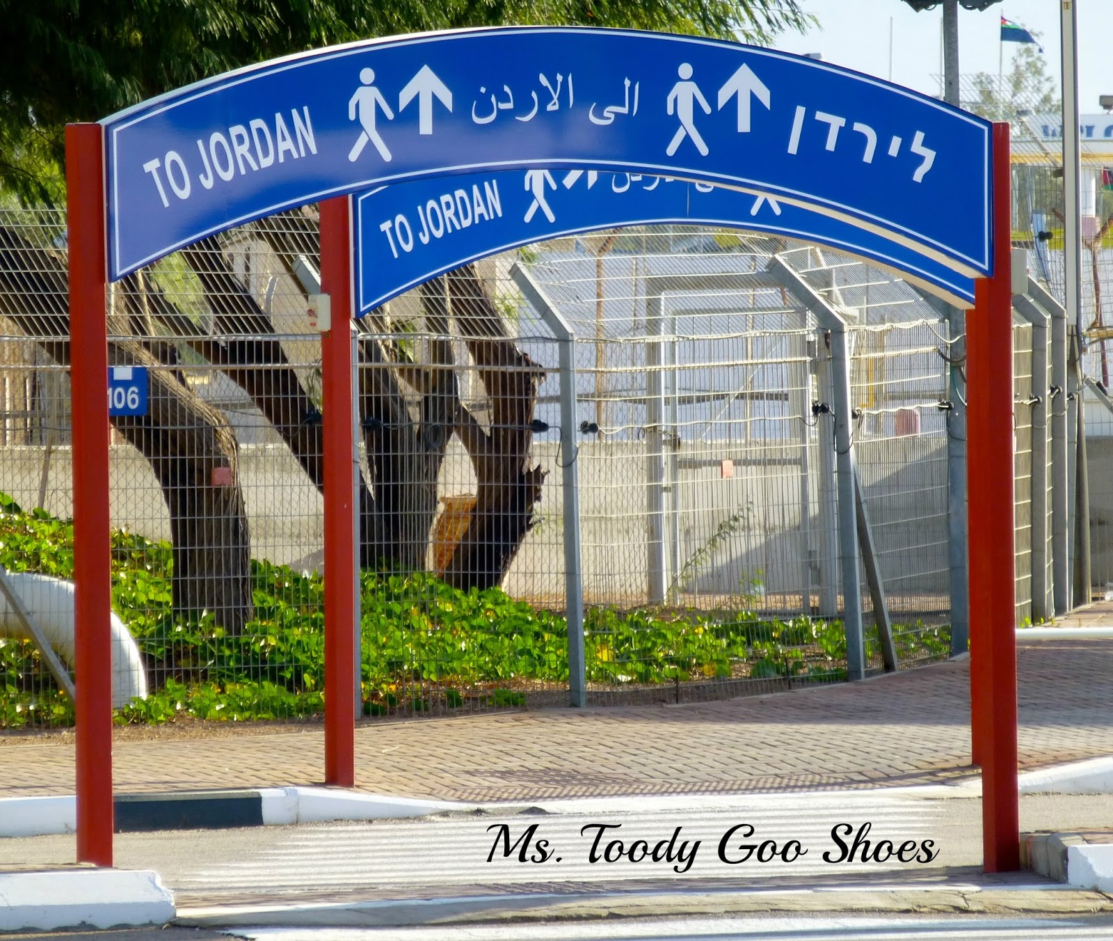 Walking across the border from Israel to Jordan --- Ms. Toody Goo Shoes