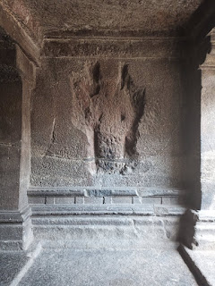 Rock carving of god in Pataleshwar Cave Temple