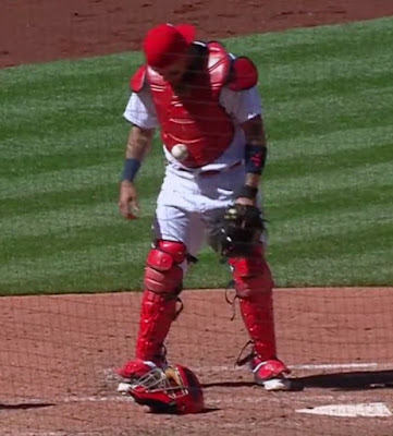 Yadier Molina got a baseball stuck on his vest