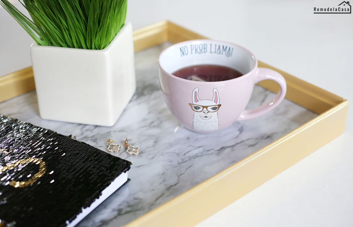 black sequins cover notebook with no prob llama mug on tray