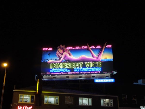 Inherent Vice moving leg neon signage billboard Sunset Strip