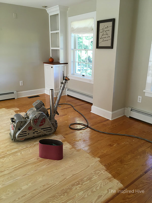 Living room before - refinishing pine floors