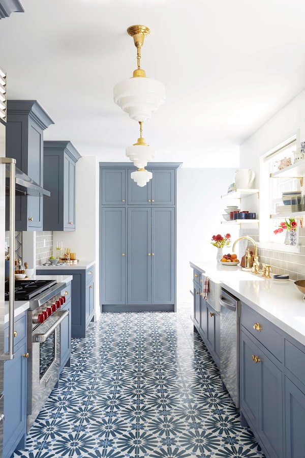 Blue kitchen with brass accents by Emily Henderson