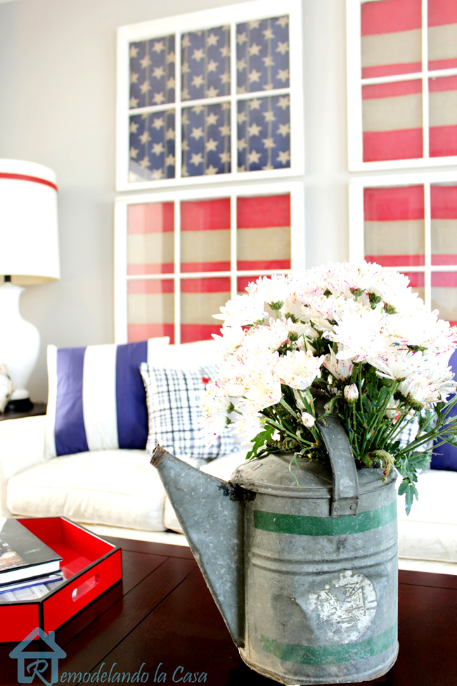 Patriotic room - sofa, pillows and old tin can full of flowers
