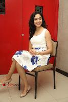 Actress Ritu Varma Stills in White Floral Short Dress at Kesava Movie Success Meet .COM 0224.JPG