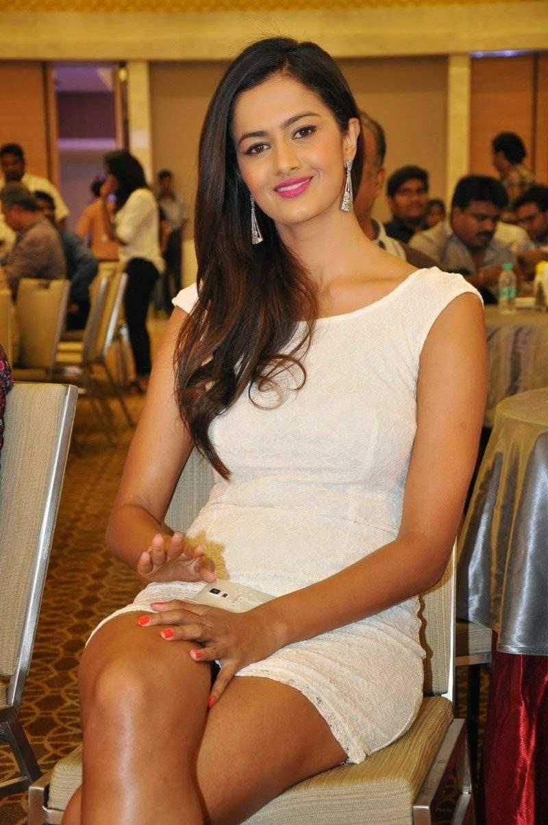 Telugu Actress Shubra Aiyappa, Shubra Aiyappa Hot Pics in White Dress Sitting on Chair