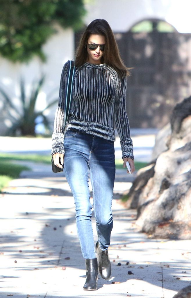 Alessandra Ambrosio street style in Sheer Sweater And Skinny Jeans at Brentwood