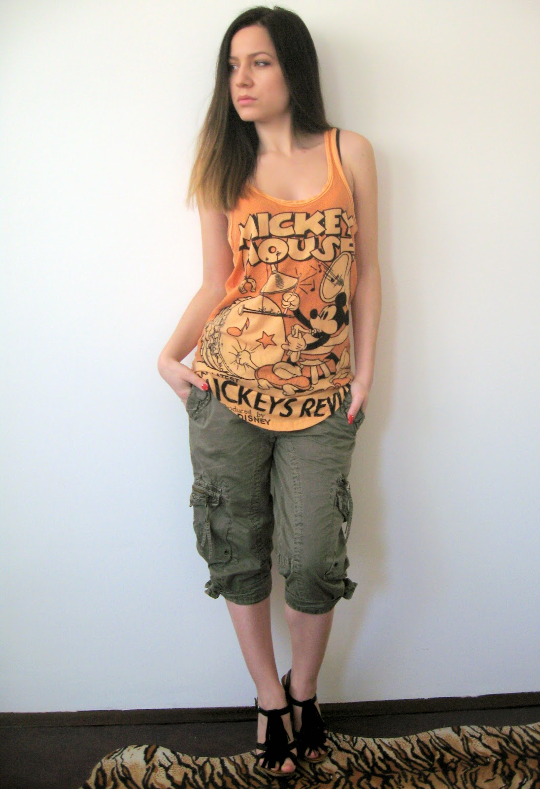 olive green cargo pants, orange tank top with mickey mouse print, black fringe sandals, black blazer, ombre hair