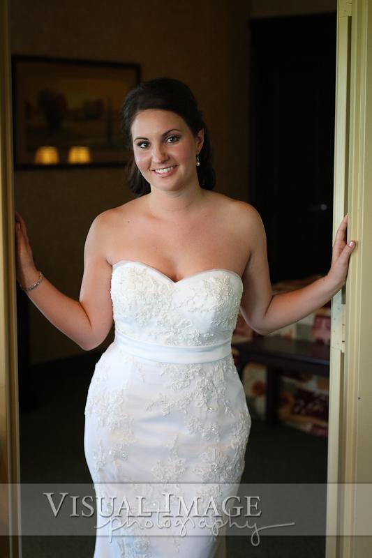 Bride in wedding gown standing in doorway