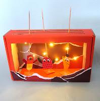 Byg et Dukketeater med lys i
