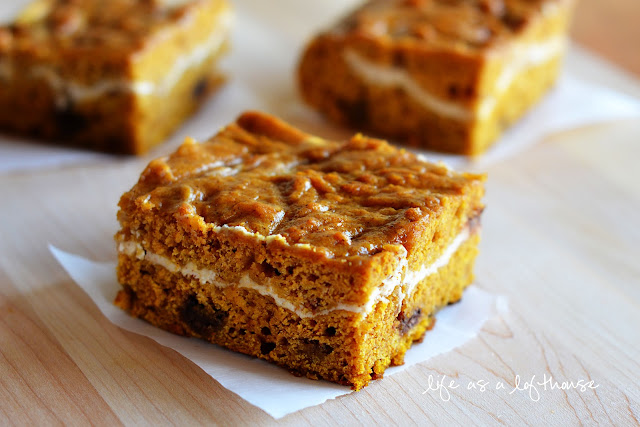 Pumpkin Chocolate Chip Bars are pumpkin heaven, with swirls of cream cheese, and milk chocolate chips. Life-in-the-Lofthouse.com