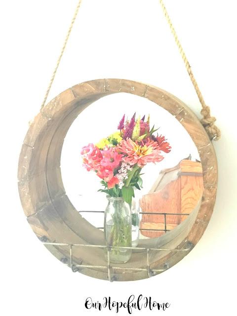 round wooden farmhouse mirror vintage milk bottle vase fresh cut flowers