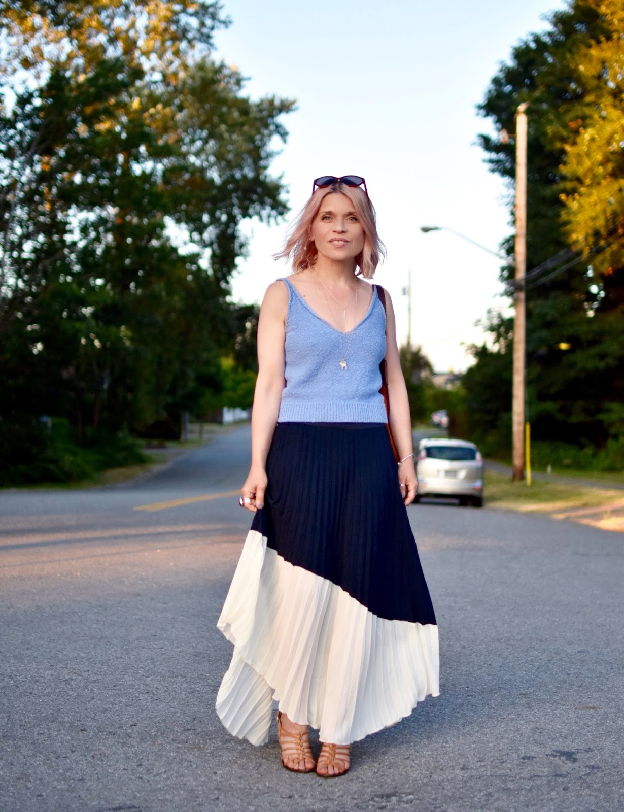 Monika Faulkner personal style inspiration - pleated asymmetrical skirt, knit tank top, strappy sandals