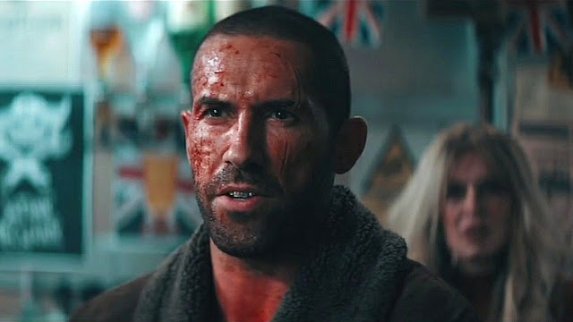 Scott Adkins covered in blood